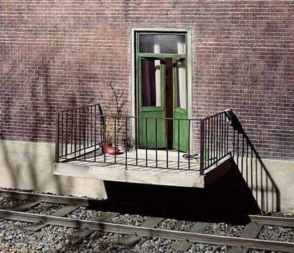 condoni-balcone-su-ferrovia